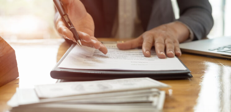 Close,Up,Business,Man,Reaching,Out,Sheet,With,Contract,Agreement