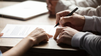 Solicitor,Pointing,At,Insurance,Contract,Showing,Male,Client,Where,To