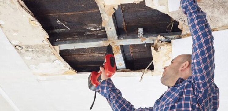 workman fixing ceiling