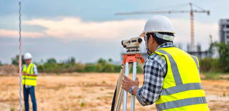Site engineer doing measurements